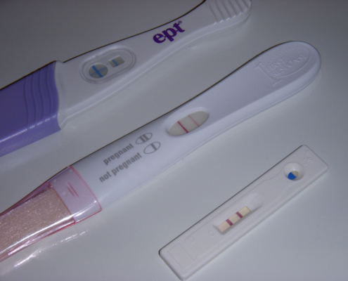 Image shows three pregnancy tests, all with a positive result