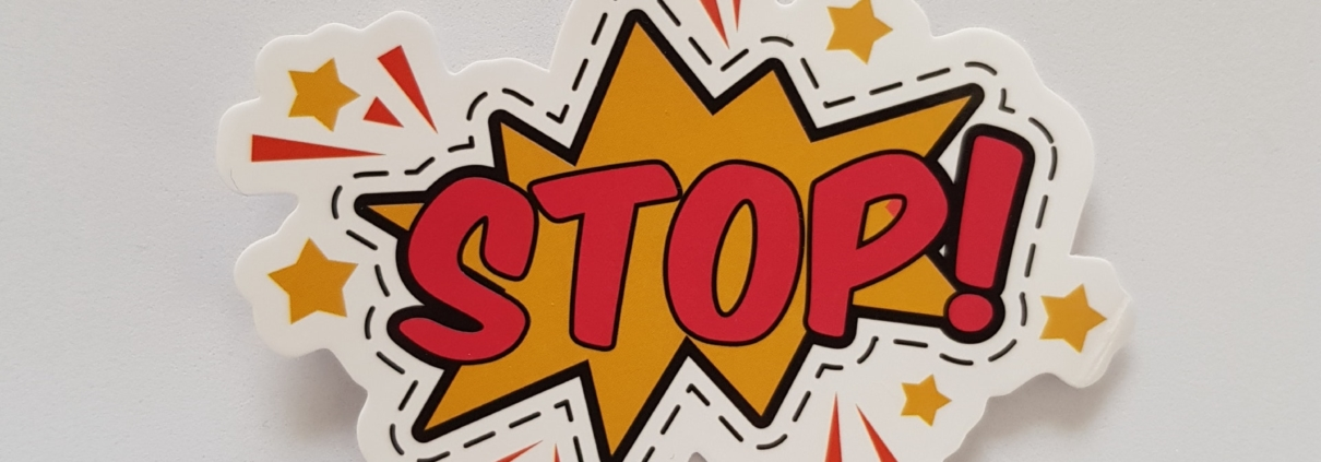 cartoon depiction of an explosion with the word STOP! in the middle