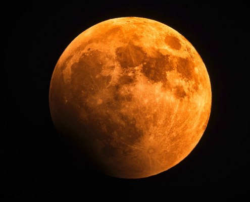 orange-red coloured full moon