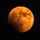 orange-red coloured full moon