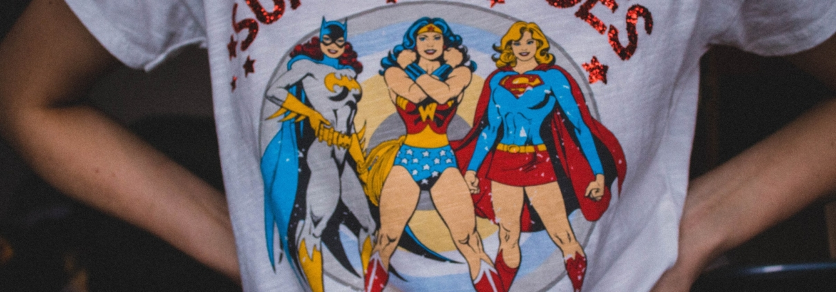 Person wearing t-shirt with women superheroes on the front