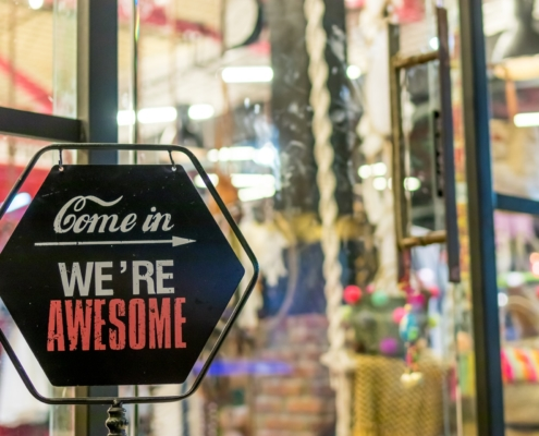 """Shop sign that says """"Come in, we're awesome"""""""