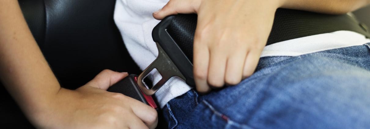 Person fastening a seatbelt