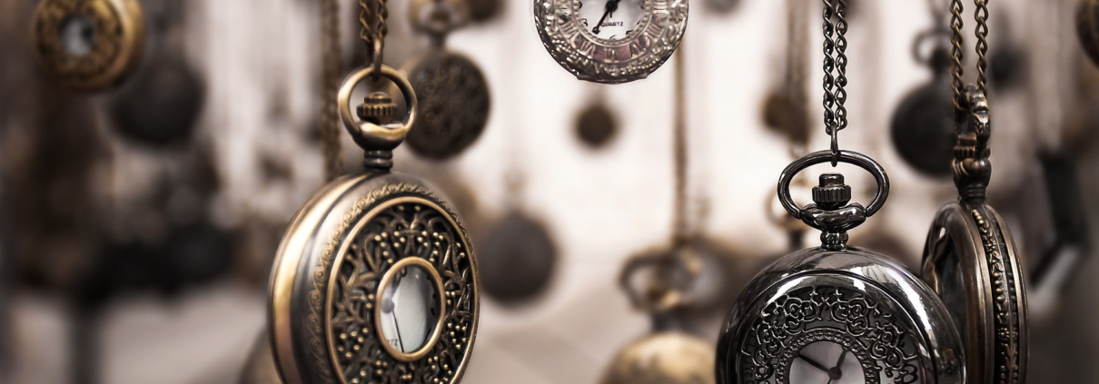 pocket watches hanging on chains