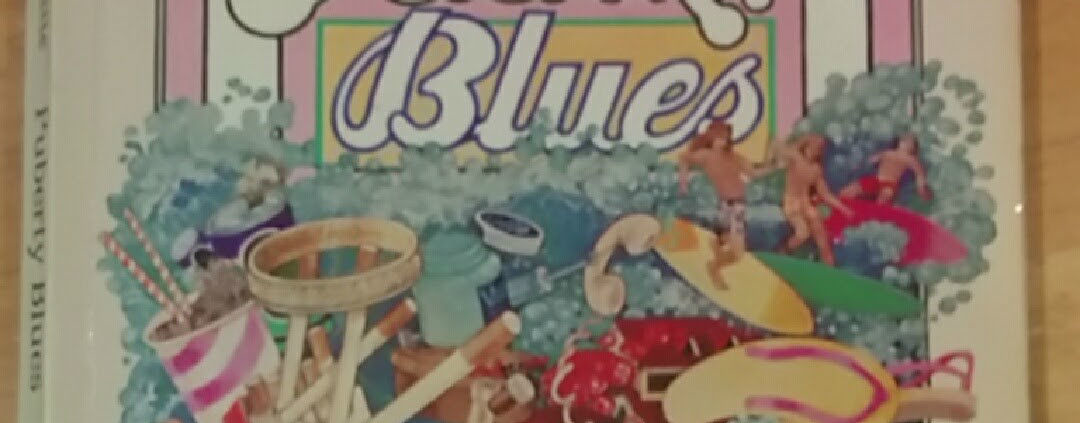 """Top half of book cover with title """"Puberty Blues"""""""