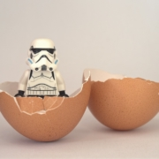 Lego stormtrooper hatching from an egg