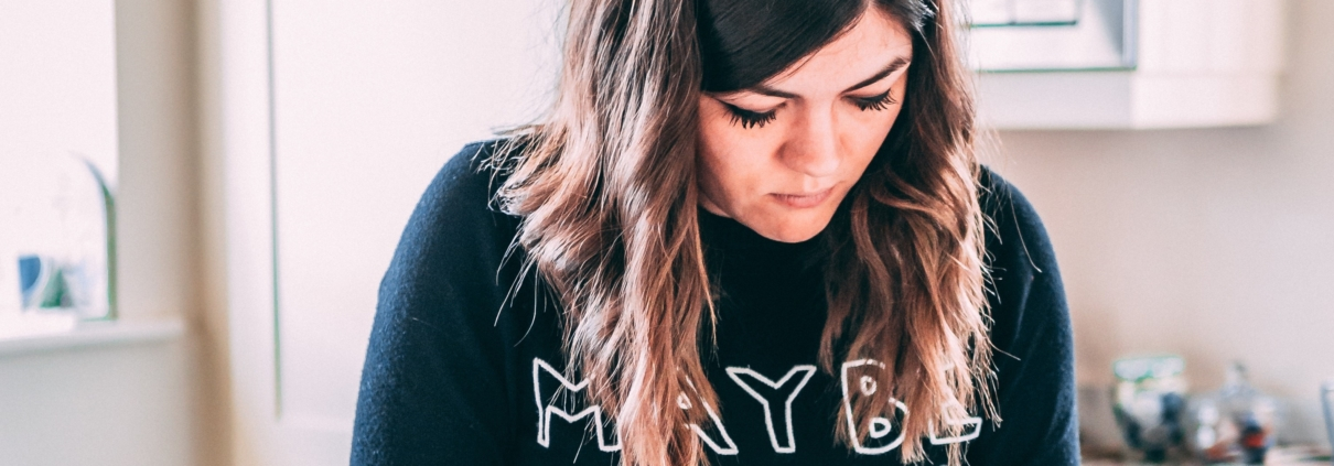 young woman wearing 'maybe baby' top
